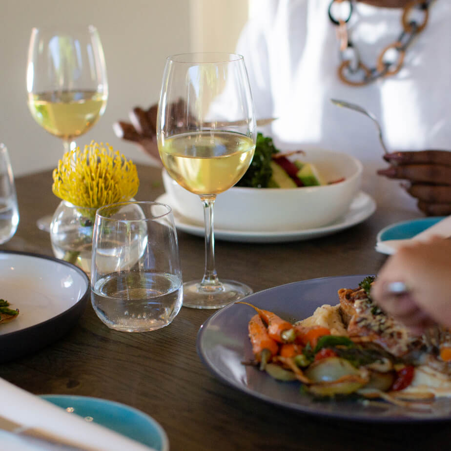 A display of vergelegen white wine in glasses served with meals at the Stables restaurant at Vergelegen